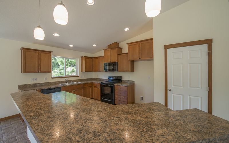 1950,Vaulted-Ceilings,Kitchen,Black-Appliances,HD-Laminate